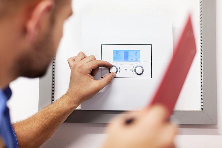 engineer repairing boiler