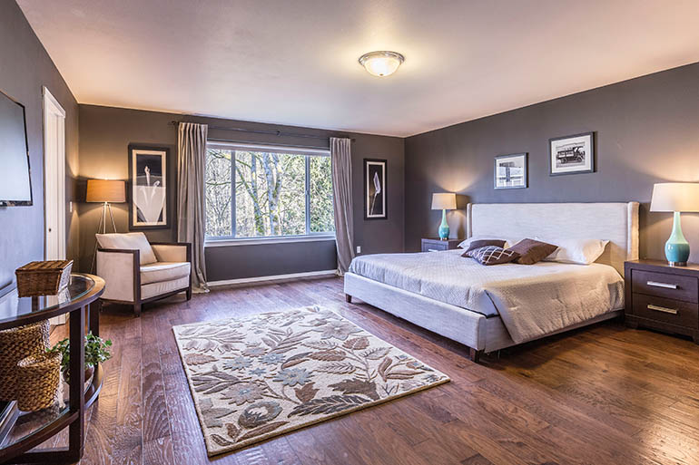 large bedroom with wood flooring