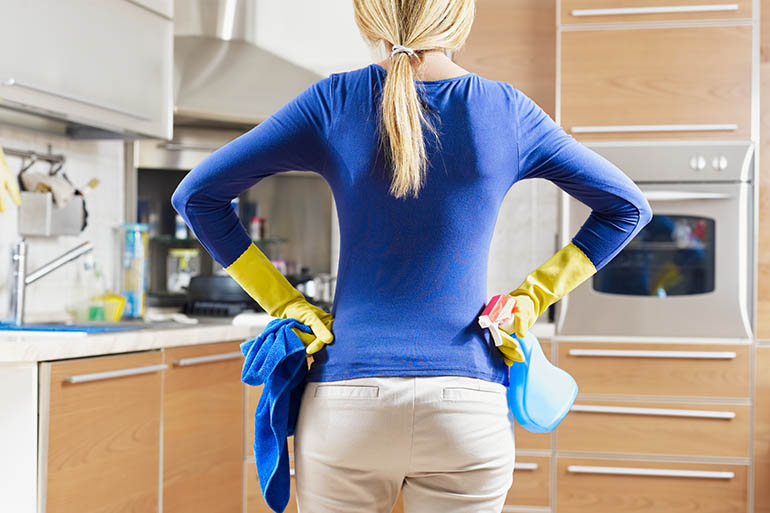 woman preparing to clean the kitchen